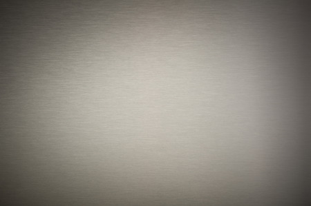 stainless steel sheet: Stainless steel, blank metal sheet, texture background closeup, intentaional strong vignetting.