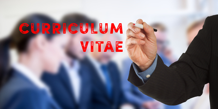 Curriculum Vitae, Male hand in business wear holding a thick pen, writing on an imaginary screen at the camera, business team in background, digital composing.