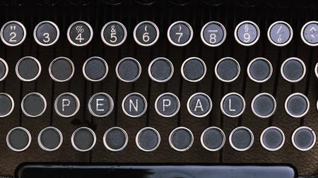 pal: Pen Pal, Word on vintage type writer letter keys from 1920s close up, digital composing.