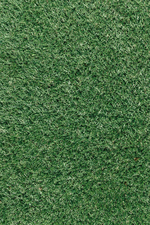 grass field from above. Green Artificial Grass On Turf Sports Field From Above, Closeup With  Details Stock Photo - Above