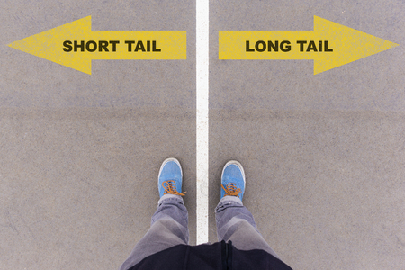 antipode: Short or long tail marketing, text on asphalt ground, feet and shoes on floor, personal perspective footsie concept