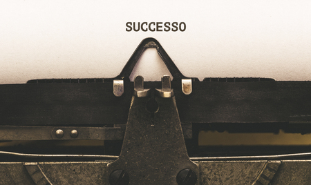 successo: Successo, Italian text for Success, on paper in vintage type writer machine from 1920s