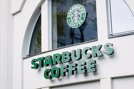 autograph: BERLIN, GERMANY - MAY 11, 2017: Starbucks coffee chain brand logo on store front at famous Kurfuerstendamm in Berlin Charlottenburg.