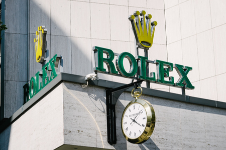 manufacturer: BERLIN, GERMANY - MAY 11, 2017: Rolex trademark brand logo of watch manufacturer on store front at famous Kurfuerstendamm in Berlin Charlottenburg. Editorial