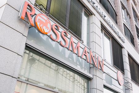 autograph: BERLIN, GERMANY - JUNE 15, 2017: Rossmann drug store trademark brand logo on store at famous Friedrichstrasse in central Berlin Mitte. Editorial