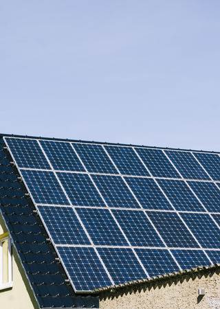 Electricity production on roof of private home with photovoltaic solar cells in Berlin, Germany Stock Photo