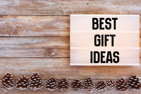 Best Gift Ideas text in lightbox on winter decorated table with pine cones