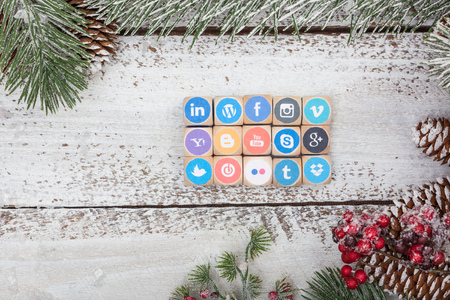 BERLIN, NOVEMBER 14, 2017 - Set of popular social media internet website brand logos printed on wood cubes on white table with Christmas decoration. Editorial