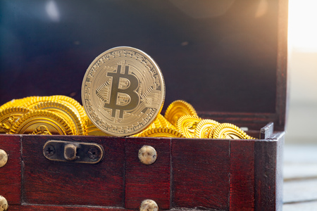 hype: Coin symbolizing blockchain cryptocurrency Bitcoin in a treasure chest Stock Photo