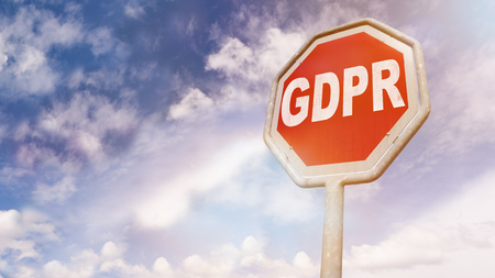 GDPR (Europen new General Data Protection Regulation, effective May 2018 on privacy) message on stop sign as warning message for legal problems