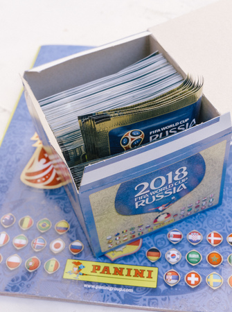 BERLIN, GERMANY - APRIL 28, 2018: Merchandise sales box and album of official FIFA licensed Panini collectibles sticker for the football world cup 2018 in Russia.