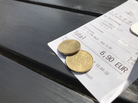 Tip left for service at open air restaurant in Germany with Euro cash coins Stock fotó