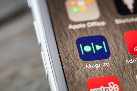 BERLIN, GERMANY - JUNE 6, 2018: Close up to Magisto social photo and video editing app on the screen of an iPhone 7 Plus with personalized background. Editorial