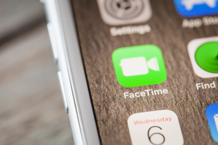 BERLIN, GERMANY - JUNE 6, 2018: Close up to Apple FaceTime video chat app on the screen of an iPhone 7 Plus with personalized background. Editorial