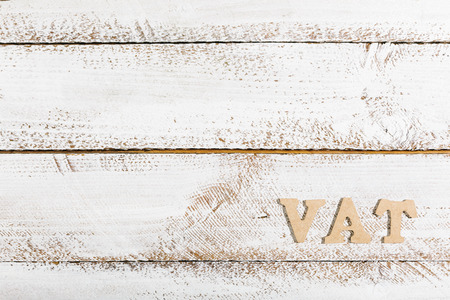 VAT word as headline on white painted table