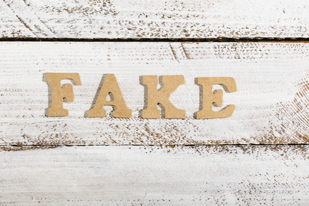 Fake word as headline on white painted table