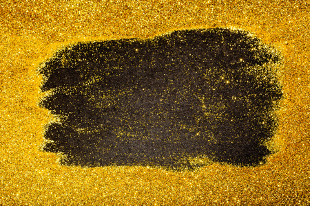 Gold glitter sparkling design background with black center area as copy space, for high value or luxury design images