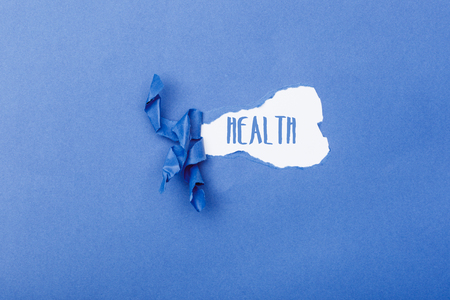 Health word message written on ripped pieces of cardboard paper