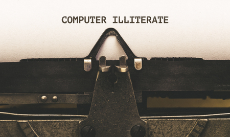 Computer Illiteare written on vintage type writer machine from 1920s closeup with paper