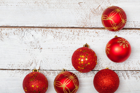 Red baubles, Christmas decoration element, high angle view from above on white board desk table Stock Photo