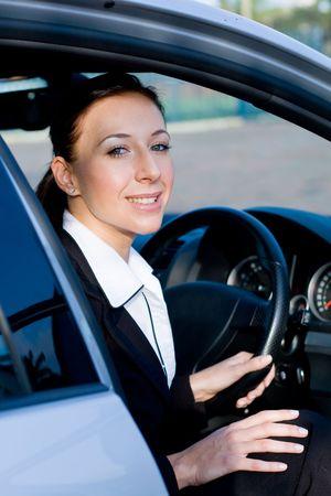 businesswoman in a car photo