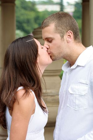 happy young couple kissing photo