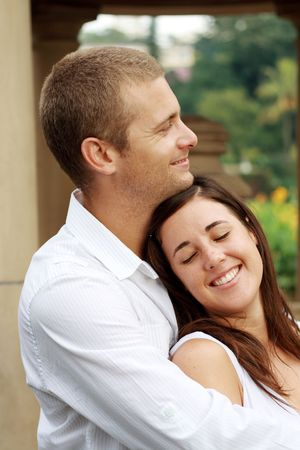 sexy girls kissing: happy young couple hugging together