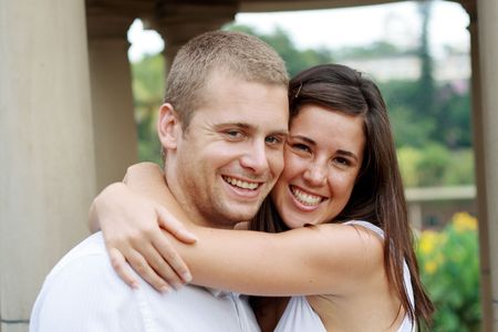 happy young couple neck hugging Stock Photo