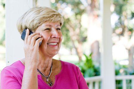 senior woman on the cellphone photo
