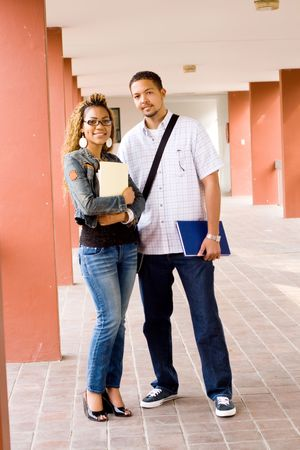 Two young african college students standing in the passage Stock Photo - 3923011