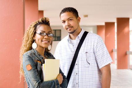 Two young african college students standing in the passage Stock Photo - 3922954