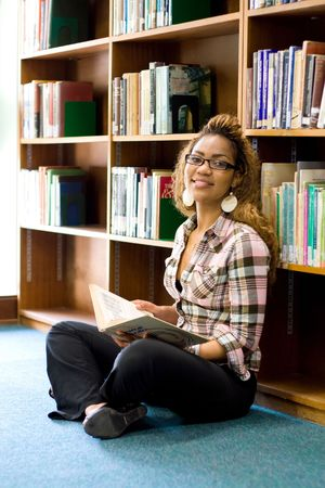 young female african student reading in library Stock Photo - 3923099
