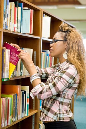 young african student in library searching for books Stock Photo - 3923095