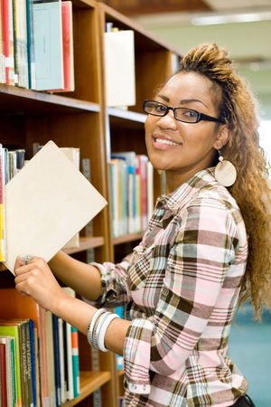 young african student in library searching for books Stock Photo - 3923091