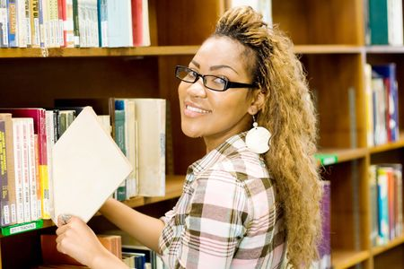 young african student in library searching for books Stock Photo - 3923065