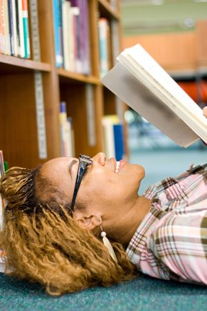 young african student reading in library Stock Photo - 3922965