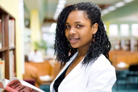 young african student reading in library Stock Photo - 3922877