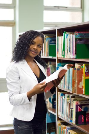 young african student reading in library Stock Photo - 3922901