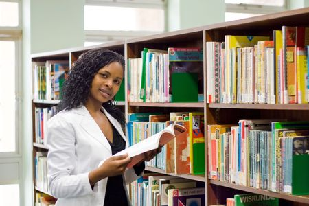 young african student reading in library Stock Photo - 3923038