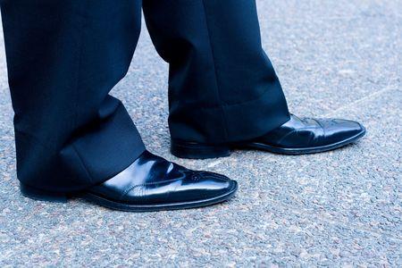 businessman shoes on concrete floor photo