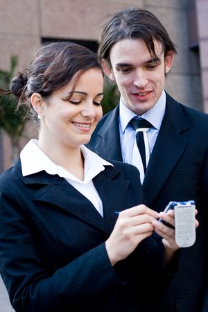 palmtop: business people using a palmtop computer Stock Photo
