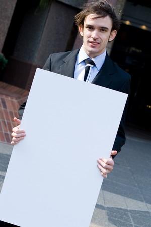 Businessman holding banner photo