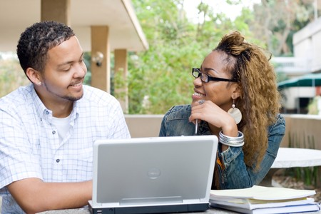 two african college students study computer together photo