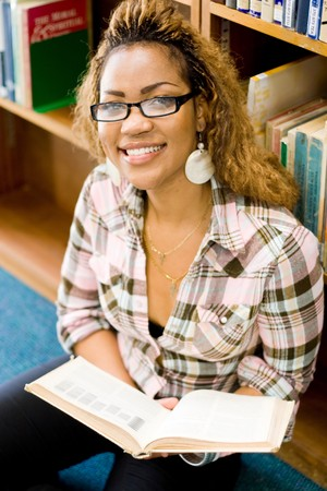young african college student reading in library photo