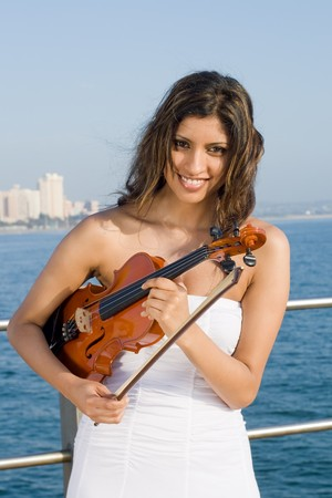 young indian woman holding violin on beach Stock Photo - 3943994