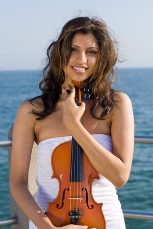 young woman holding a violin in front of her body Stock Photo - 3944215