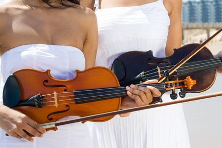 two female violinist holding violins photo