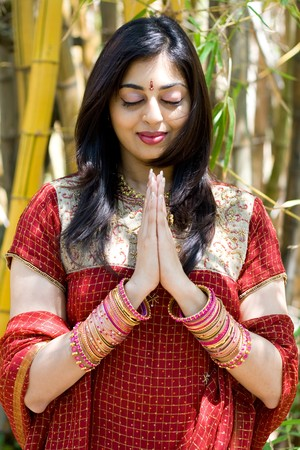 eye wear: indian woman praying in the bamboo forest