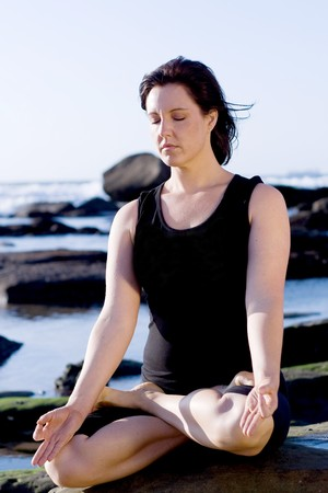 sportswoman: caucasian woman practise yoga on beach