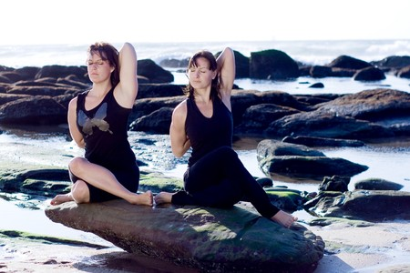 two young yoga women on the beach photo